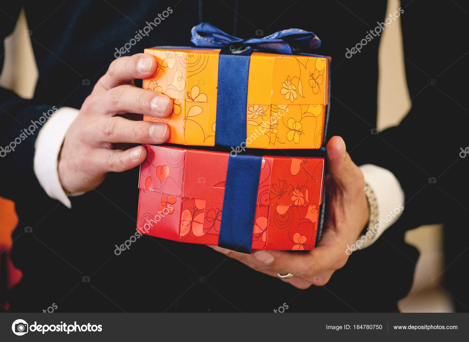 Close Up Shot Of Businessman Hands Holding Bright Gift Boxes Wrapped With Blue Ribbon Christmas New Year Birthday Valentine Day Concept Stock Image