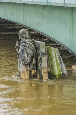 Zouave statue (1850) is most famous feature of Pont de Alma. The Zouave statue has acted as a measuring instrument during the floods. Paris, France.