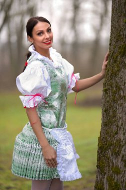 Young beautiful slovak woman in traditional costume