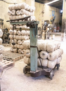Image of a scale with a finished and packed rope in an old factory of henequen rope (fourcroiydes agave)