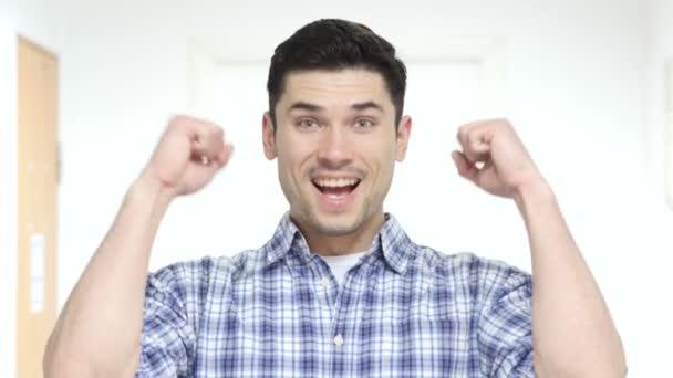 Portrait of Winning Man Celebrating Success