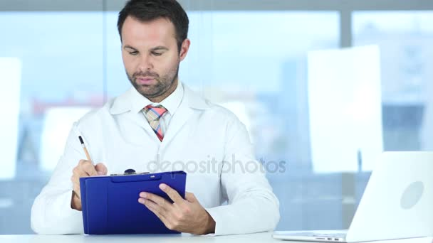 Doctor Writing Medical Reports of Patient, Sitting in Front
