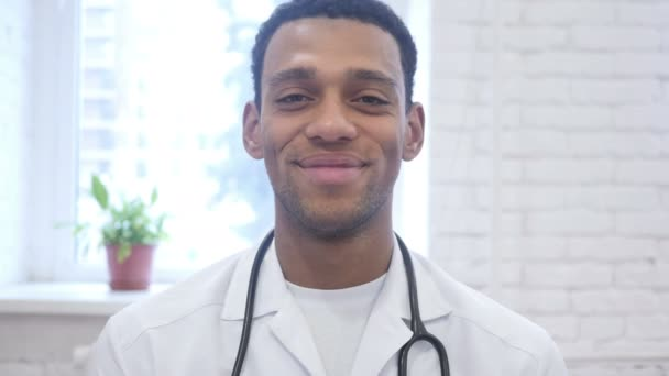 Smiling Happy African American Doctor Looking at Camera in Clinic