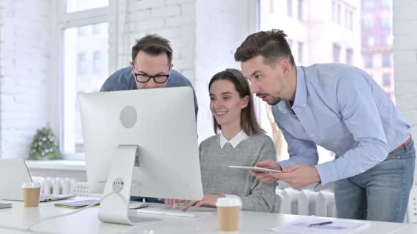 Focused Startup Team Working Together on Desktop and Tablet