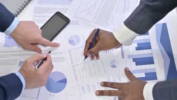 Close up of Hands of Professional Team working on Financial Documents