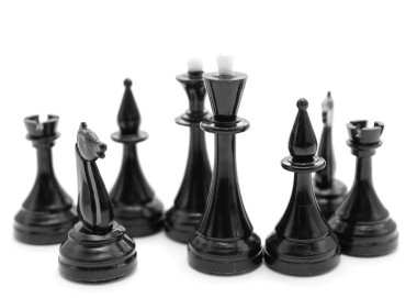black chess pieces on white background