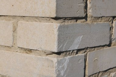Gray background of white building silicate brick