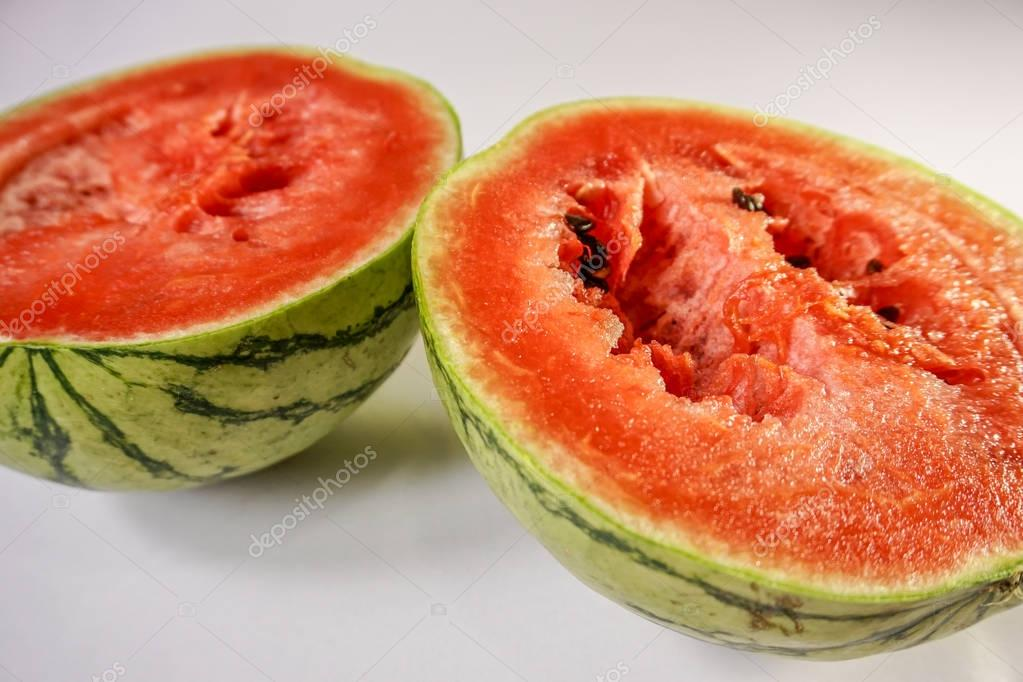 Two watermelon slices on white background