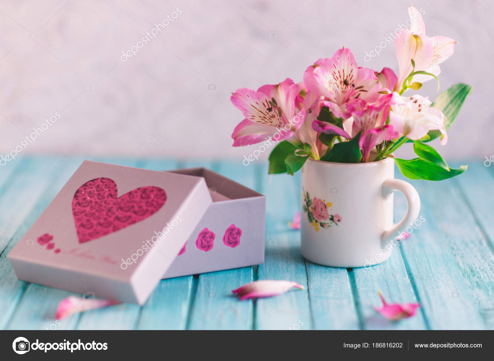 Bouquet of flowers in a white mug with a white box stock photo cute bouquet of flowers in a white mug with a white box photo by sonchachamail izmirmasajfo
