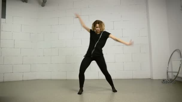 Asian young woman dances in studio modern and street choreography Jazz-funk