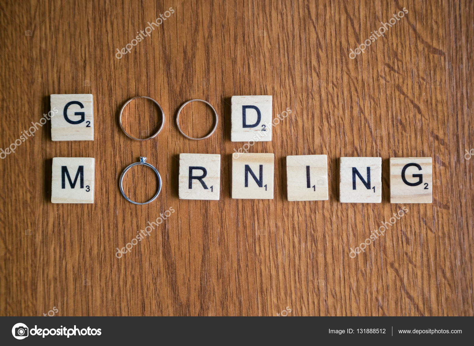 Words Good Morning With Wedding Rings And Scrabble Pieces Stock