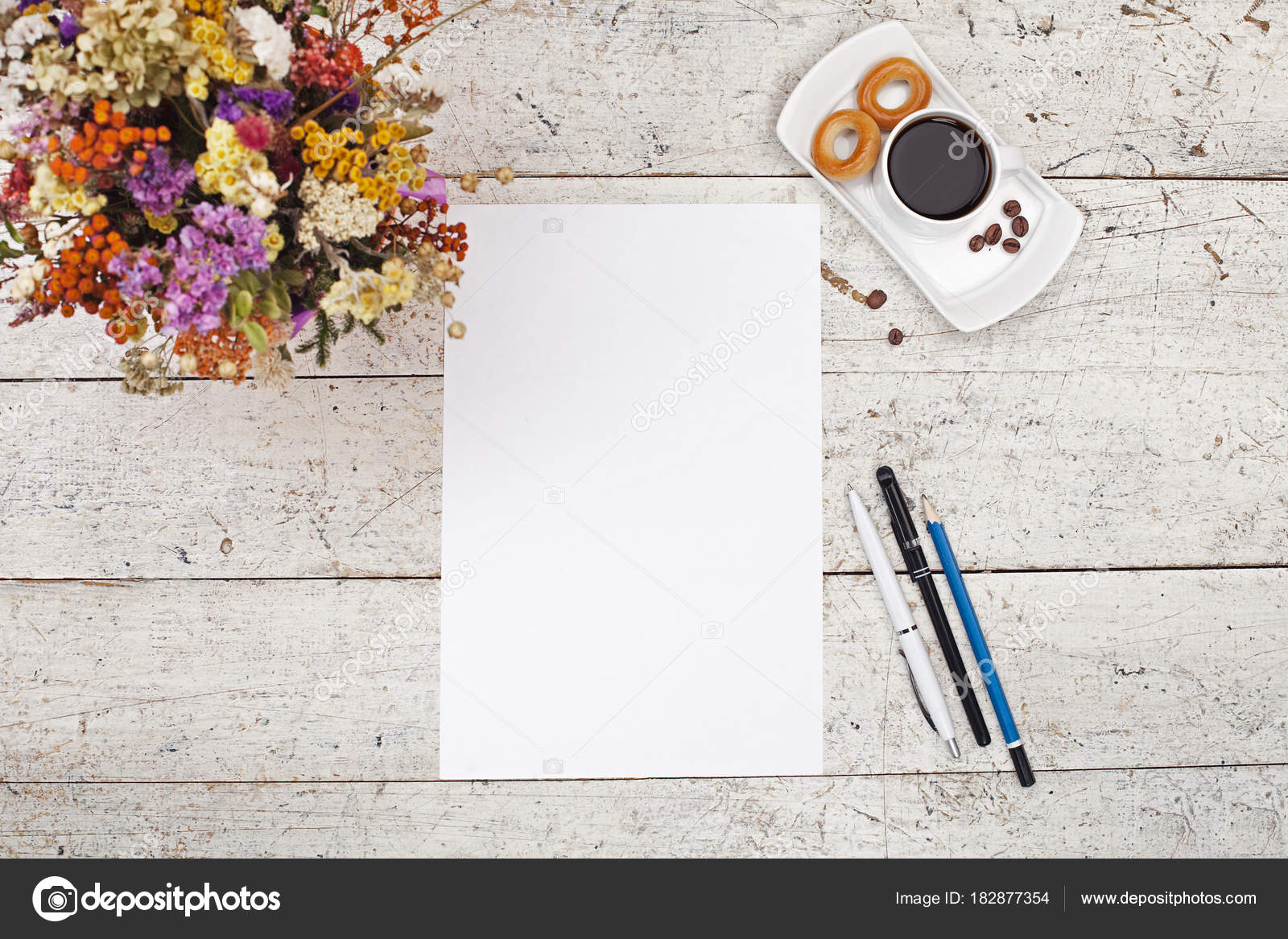 Flowers pens pencils white sheet of paper and coffee stock flowers pens pencils white sheet of paper and coffee on a light wooden backgroun photo by artofgalaxy mightylinksfo