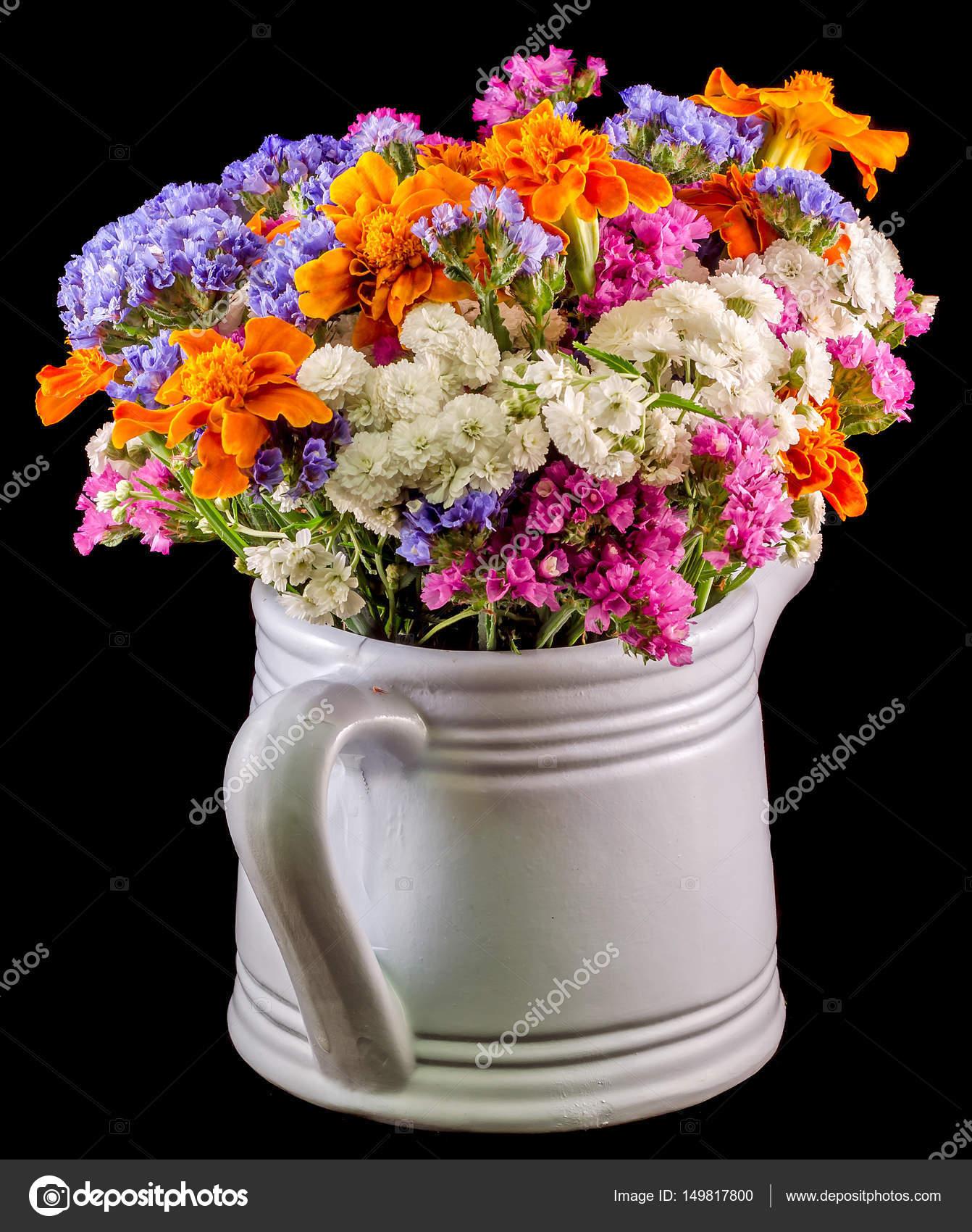 White ceramic watercan sprinkler with vivid colored flowers white ceramic watercan sprinkler with vivid colored flowers stock photo mightylinksfo