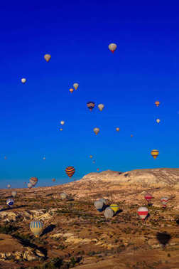 Hot air balloon flying over valleys in Cappadocia Turkey