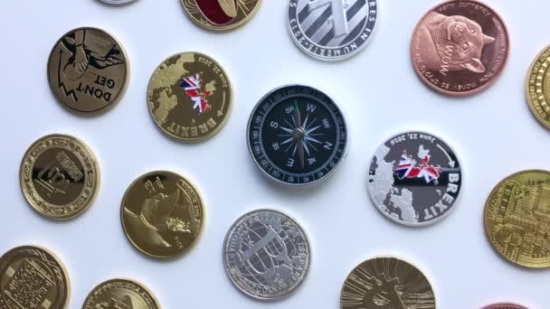 Physical cryptocurrency coins compass