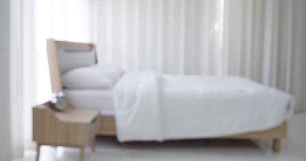 Dolly shot with blurred bed, Clean and comfortable with interior of cozy bedroom in modern design, background video for insert design media