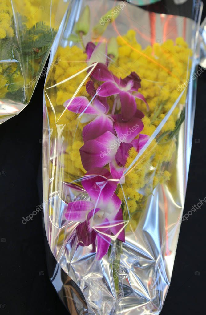 bouquet of yellow mimosas with an orchid