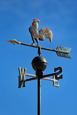 weather vane to indicate the wind direction with arrows of Cardi
