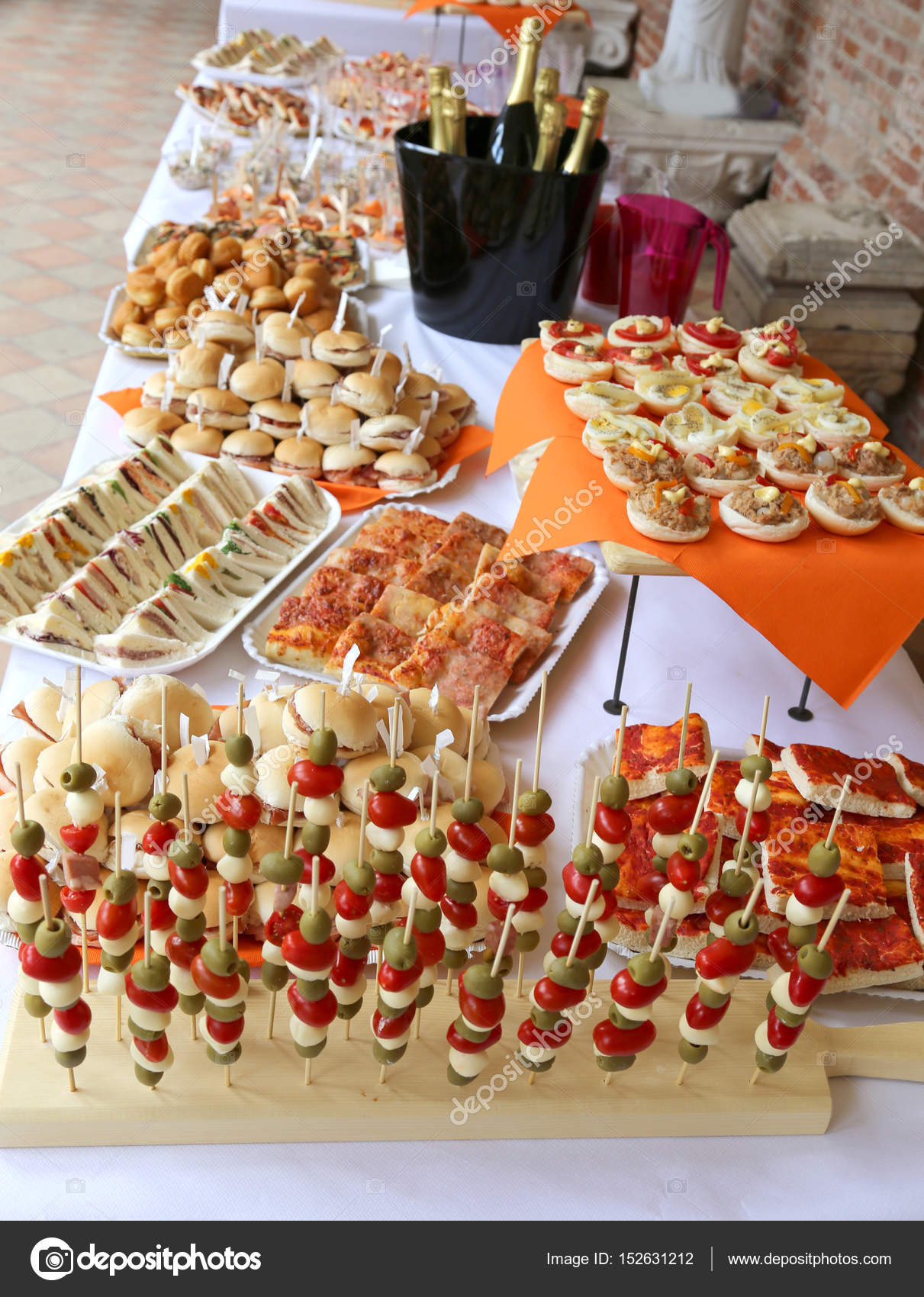 Tasty Sandwiches And Many Snack Food On The Table Of