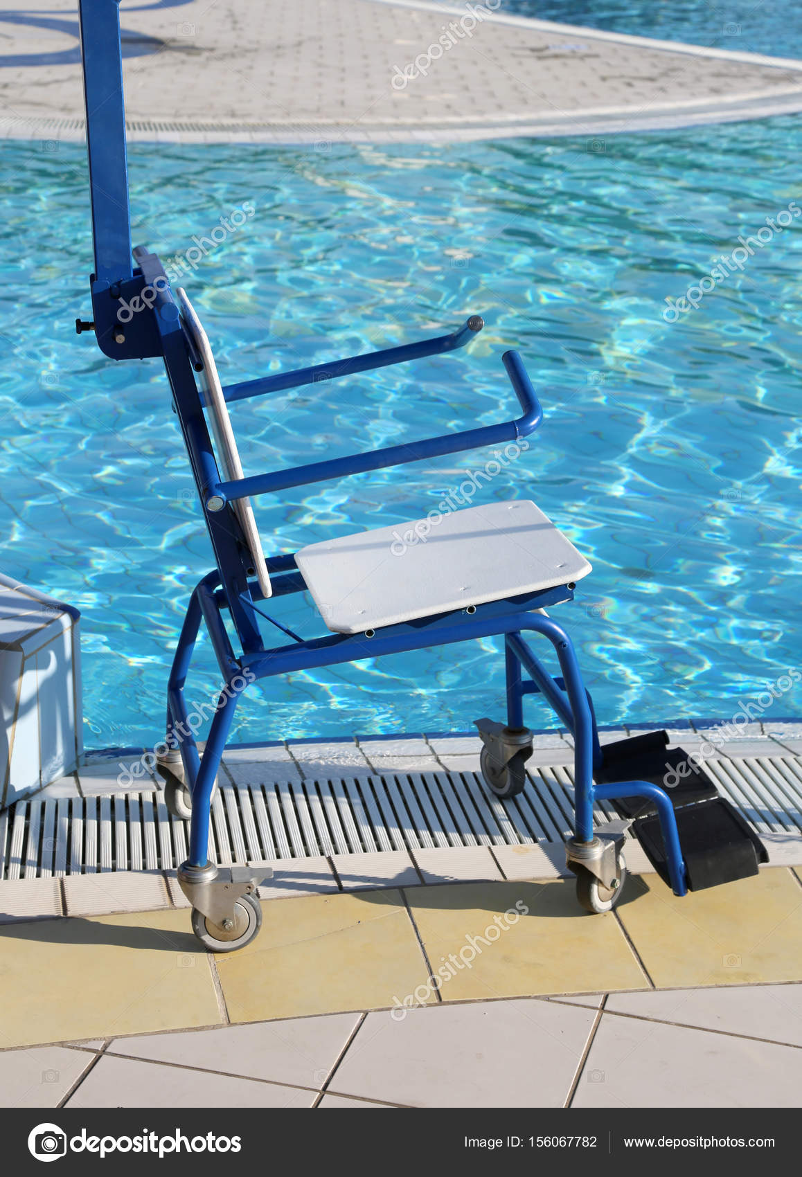 wheelchair for disabled people at the swimming pool — Stock Photo ...