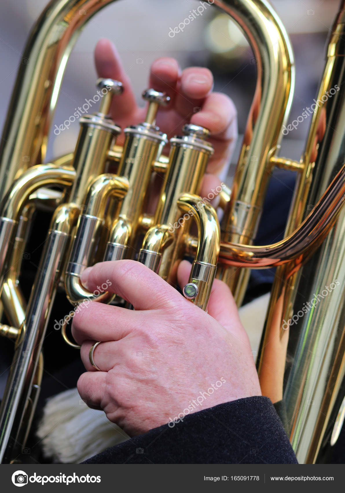 hand of man plays the trombone in the brass band — Stock Photo