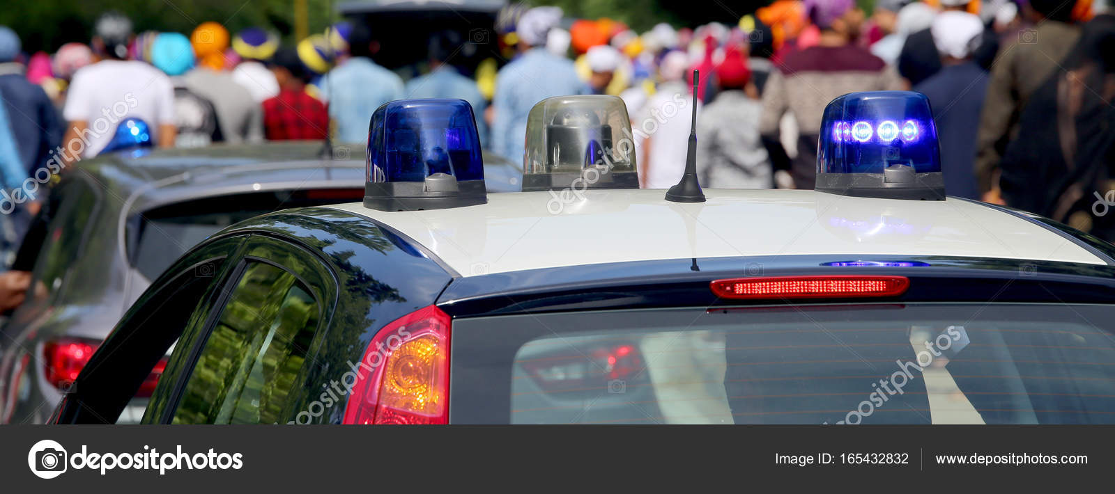 police cars flashing sirens in the city — stock photo © chiccododifc
