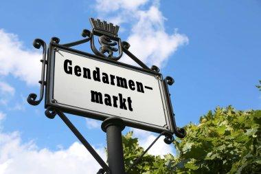 road sign indicating the square called Gendarmenmarkt inEast Ber