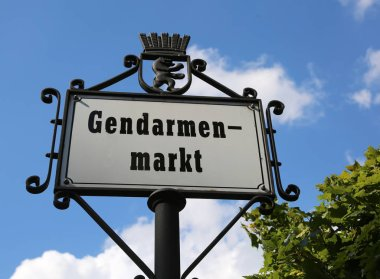 main square of Berlin in the road sign called Gendarmenmarkt tha