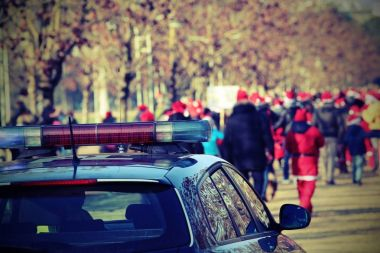 police car and many people with red hat with vintage effect