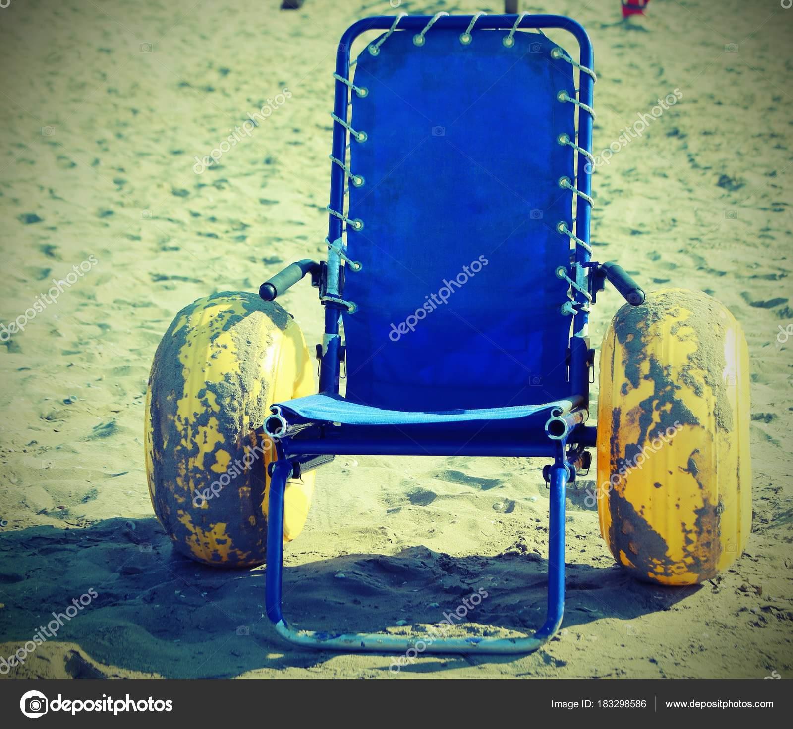 Strange Wheelchair With Large Yellow Inflatable Wheels Stock Photo Interior Design Ideas Tzicisoteloinfo
