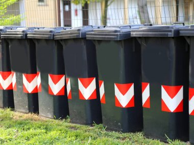 garbage cans in a condominium yard for the separate collection o