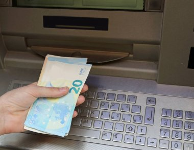 atm machine and european banknotes
