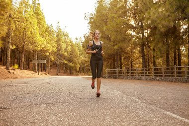 young girl runs on road