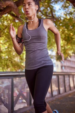 young woman in sport clothes running