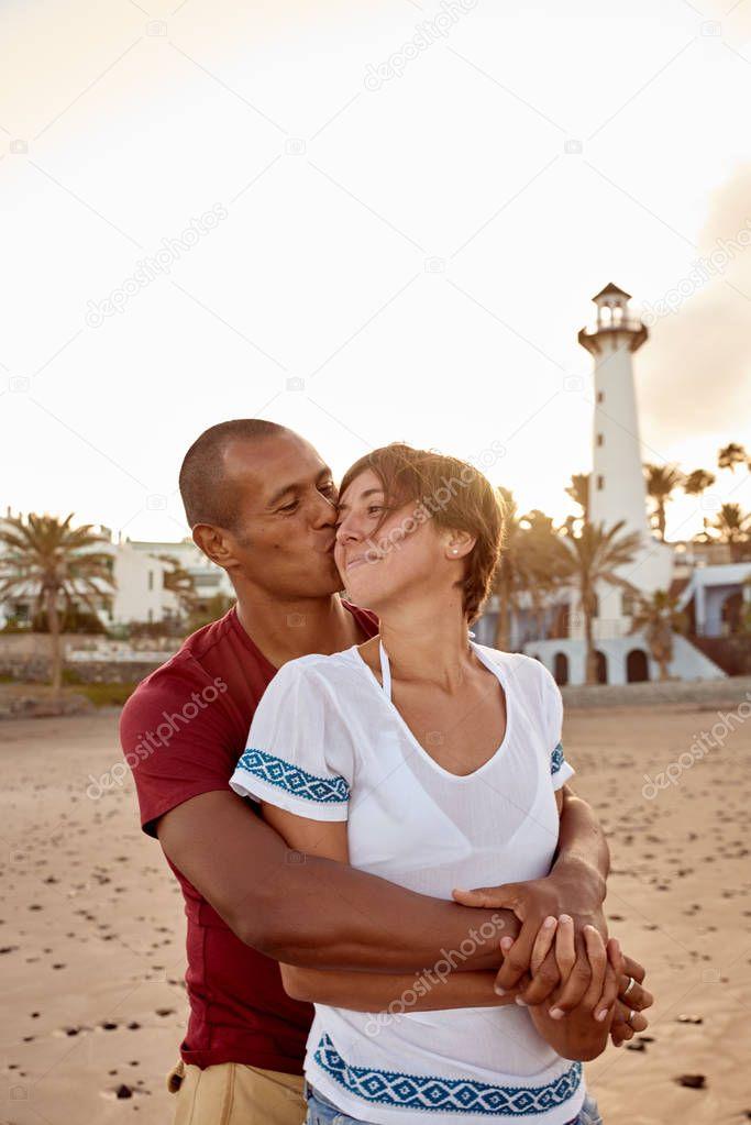 Loving adult couple on beach