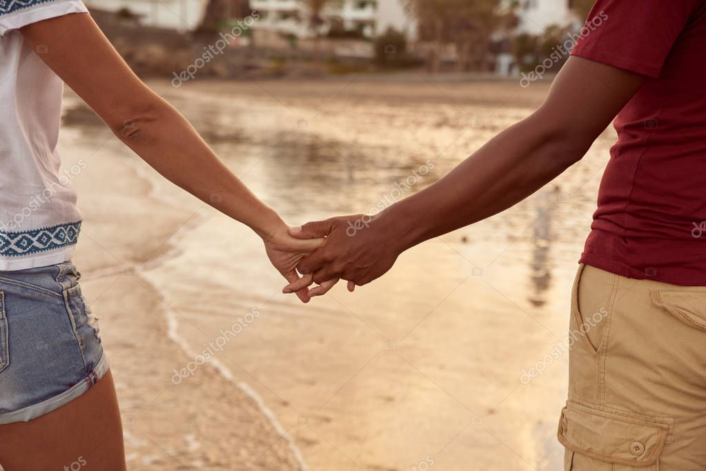 couple holding hands together