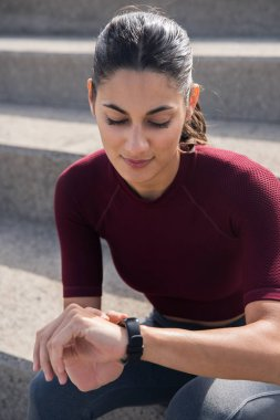 young woman looking at watch