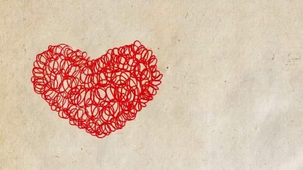Doodle ve tvaru srdce. Papírové pozadí. Symbol lásky na Valentýna. Designový prvek. Ručně kreslená animace.