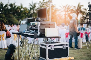 Dj mixing equalizer at outdoor in music party festival with part