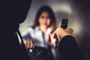 Robber force woman to steal her wallet or handbag by hand gun. Fear of women during facing and giving wallet to thieves. Criminal sexual and illegal violence crisis concept