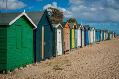 2016 United Kingdom Mersea colorful houses on the coast. Beautiful wide beach with interesting buildings