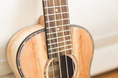 Upscale ukulele with woodgrain finish