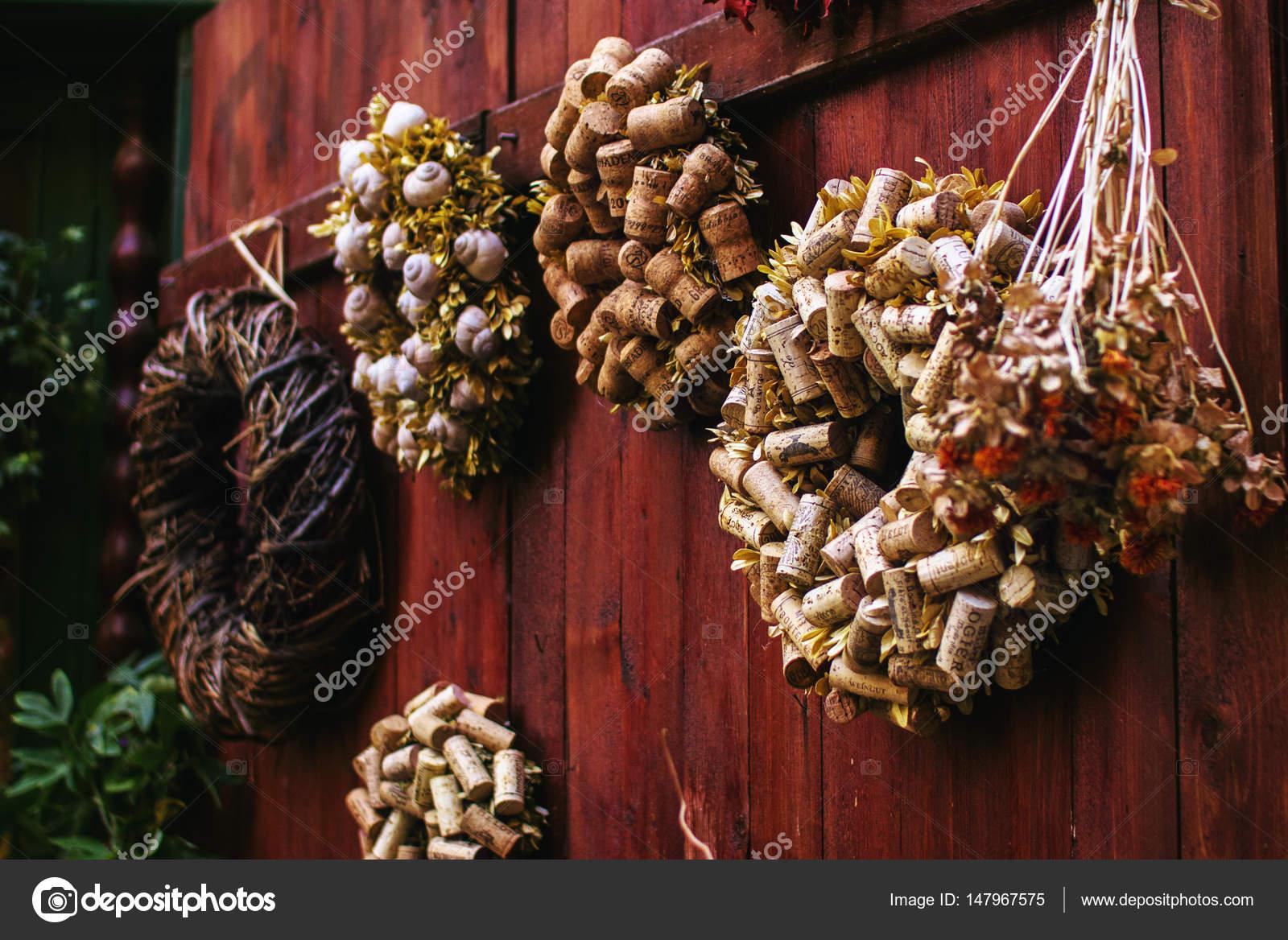 Wreath decoration of wine corks on wooden door — Stock Photo ...