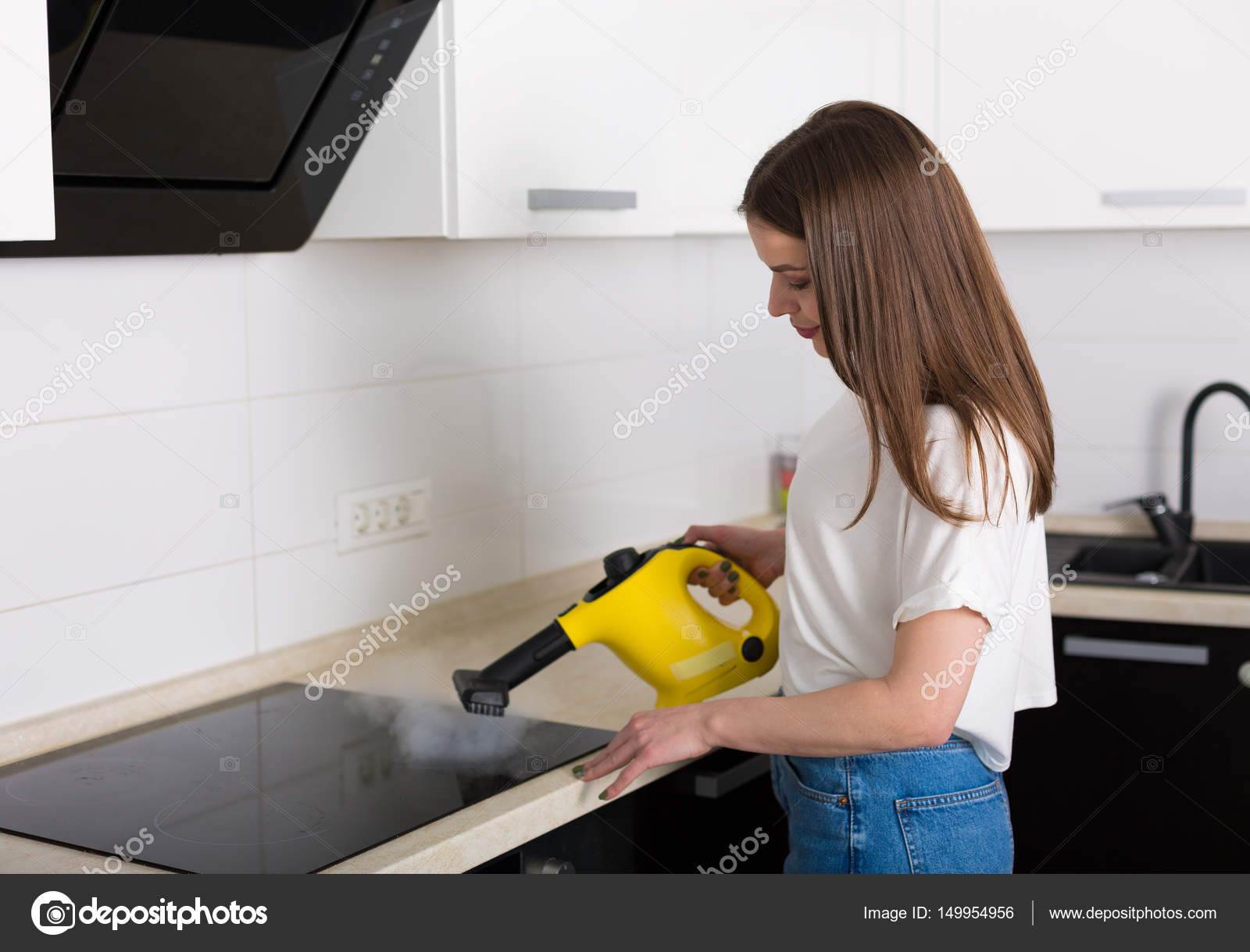 Woman cleaning kitchen with steam cleaner — Stock Photo © Tinatin1 ...