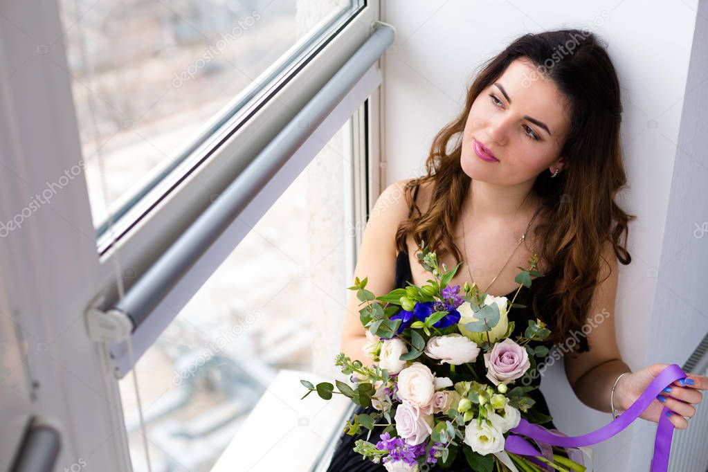 Beautiful woman with a lovely bouquet