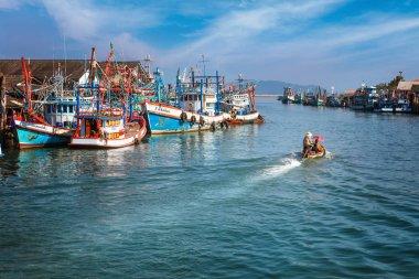 Chumphon, Thailand - 9 February 2014: Fishing boats at the coastal fishing villages. Preparation sea fishing. entering the sea along the pier