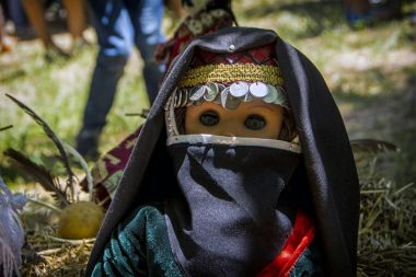 A doll in a traditional national Armenian costume at Mulberry festival in Karahunj village, Armenia