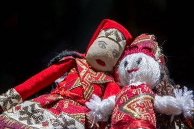Rag dolls in a traditional national Armenian costume at Mulberry festival in Karahunj village, Armenia