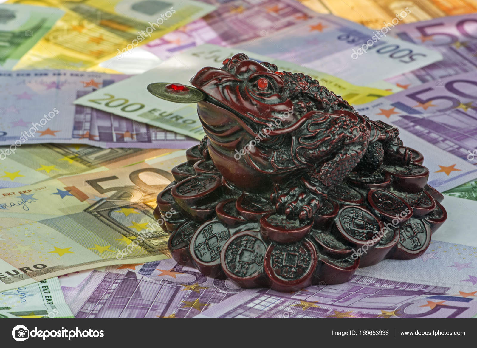 Three legged money toad jin chan as a chinese symbol of wealth on three legged money toad jin chan as a chinese symbol of wealth on variety of euro currency eur with 500 200 100 and 50 euro bank notes many money biocorpaavc Images