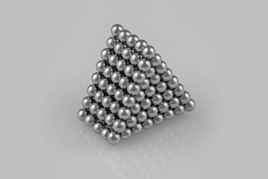 magnetic metal balls in triangular prism shape on white background